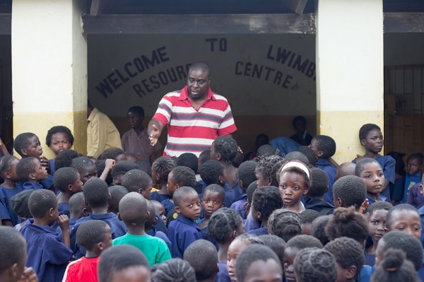 Alfred Mwamba, CURE Zambia's Audiologist and the only Audiologist in Zambia, attempts to organize the children in lines by school year.