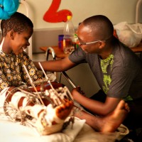 Spiritual Director with patient at CURE Malawi