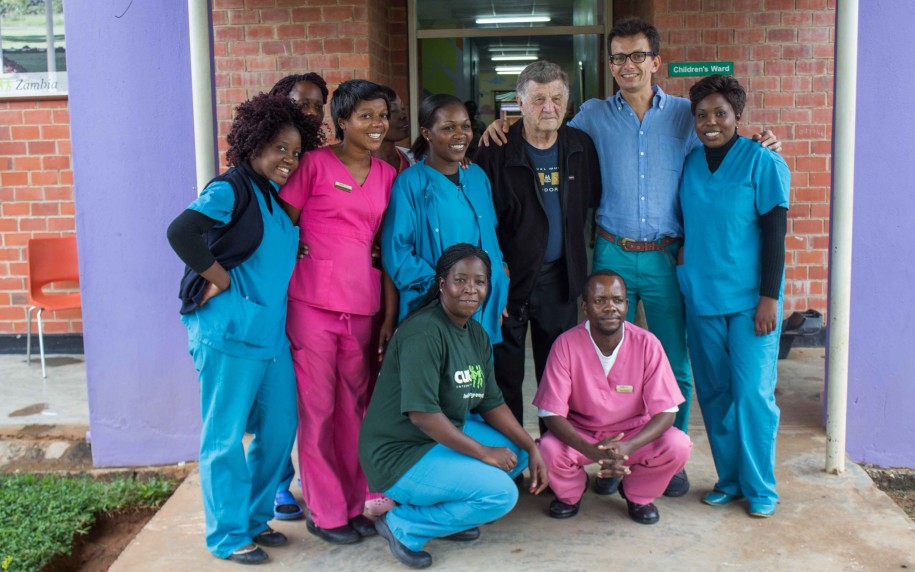 CURE Zambia doctors and nurses pose for a group photo with visiting Doctor Clawson after a hectic week of cleft lip and palate surgeries