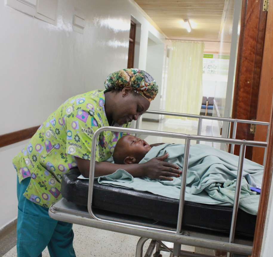 Gladys consoles Moses after a successful surgery as she waits to hand him over to his mother
