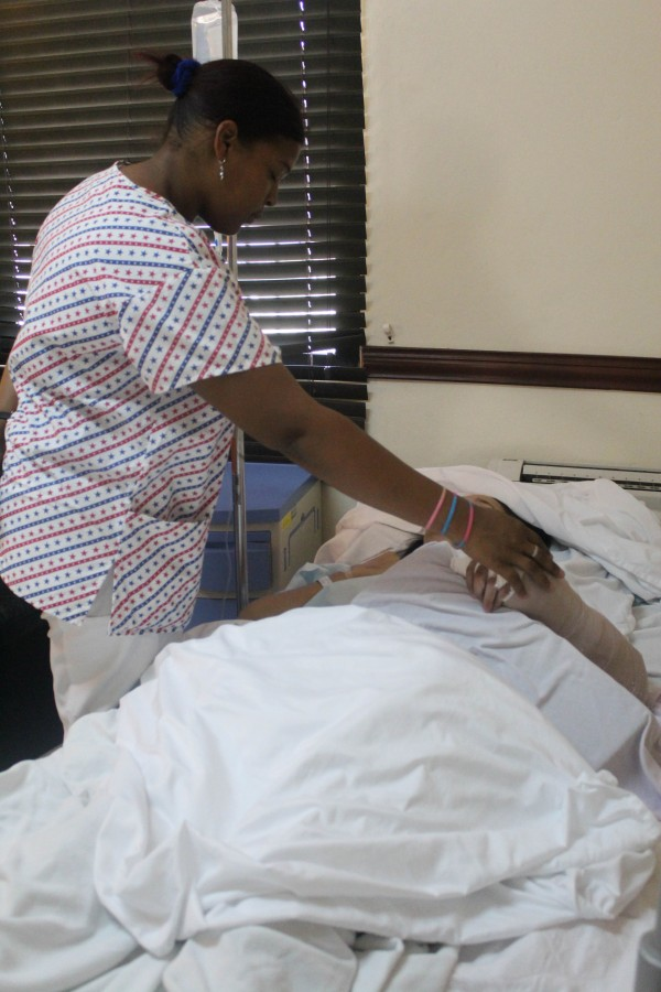 Nurse Laura comforts a patient