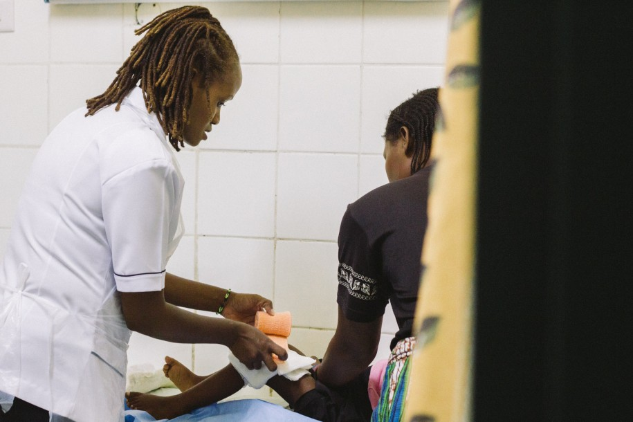 Mukonde expertly bandages up a patient's leg