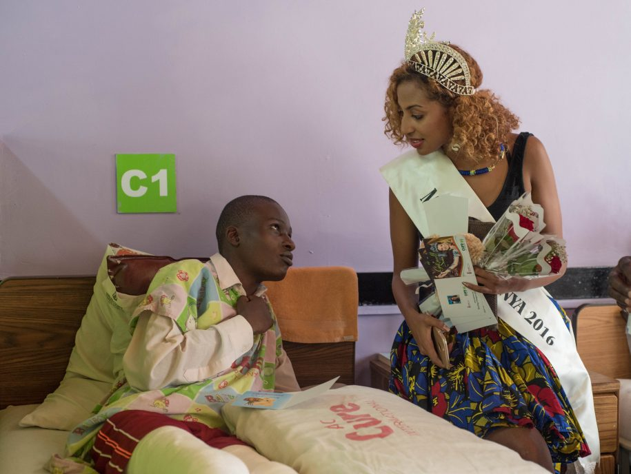 Miss world Kenya takes her time to have a word with Trevor after giving him a get well card.