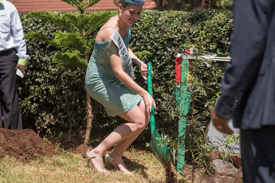 Time to get her hands dirty. Lalaguna plants a tree at CURE Kenya.