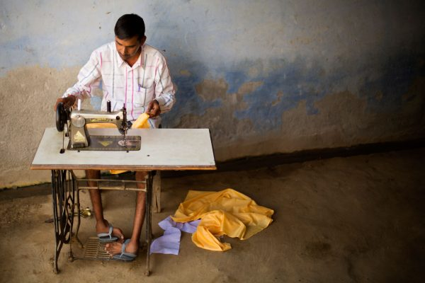 Betpal found work as a tailor, but every pedal stroke brings pain.