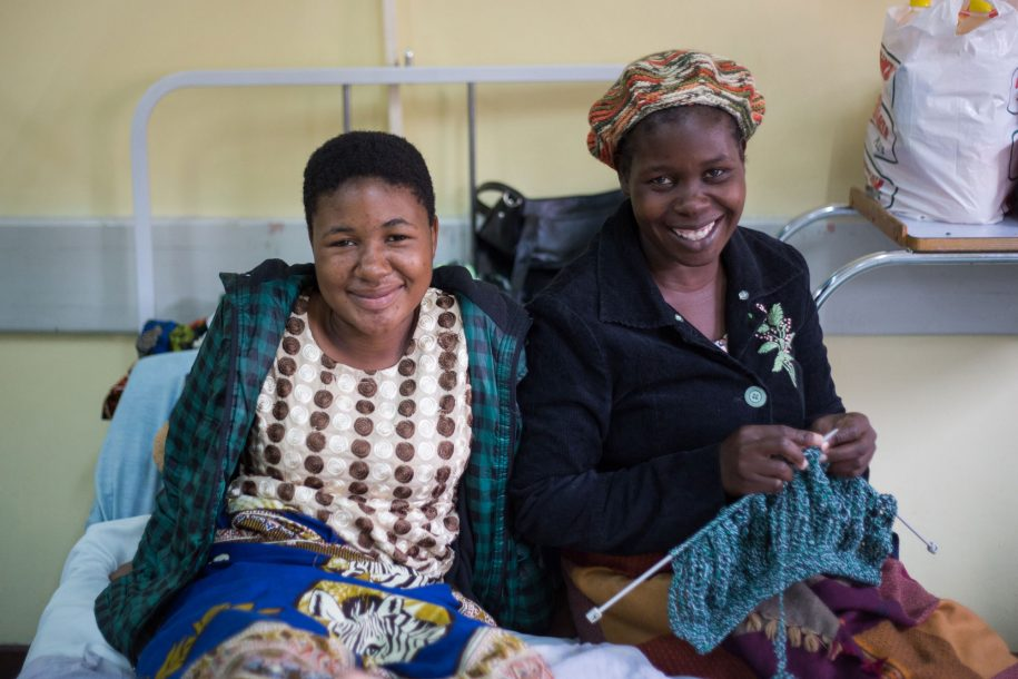 Tiyanjane and her mom, Ellen, pose for a photo together! Ellen's knitting another hat—she finished the one she was wearing during their time in the hospital, and we can't wait to see how the new one turns out!