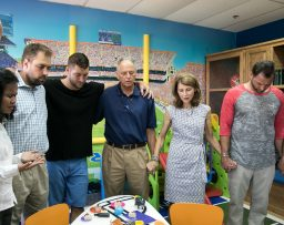 Pastor Bob Tebow leads members of the Tim Tebow Foundation and CURE in prayer for Timmy's Playroom and the kids who spend time there.
