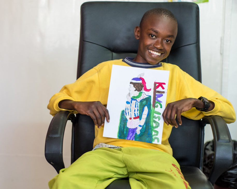 Meet King Isaac, an artist. Isaac, one of our patients, shows off a painting he did at our playroom this week.