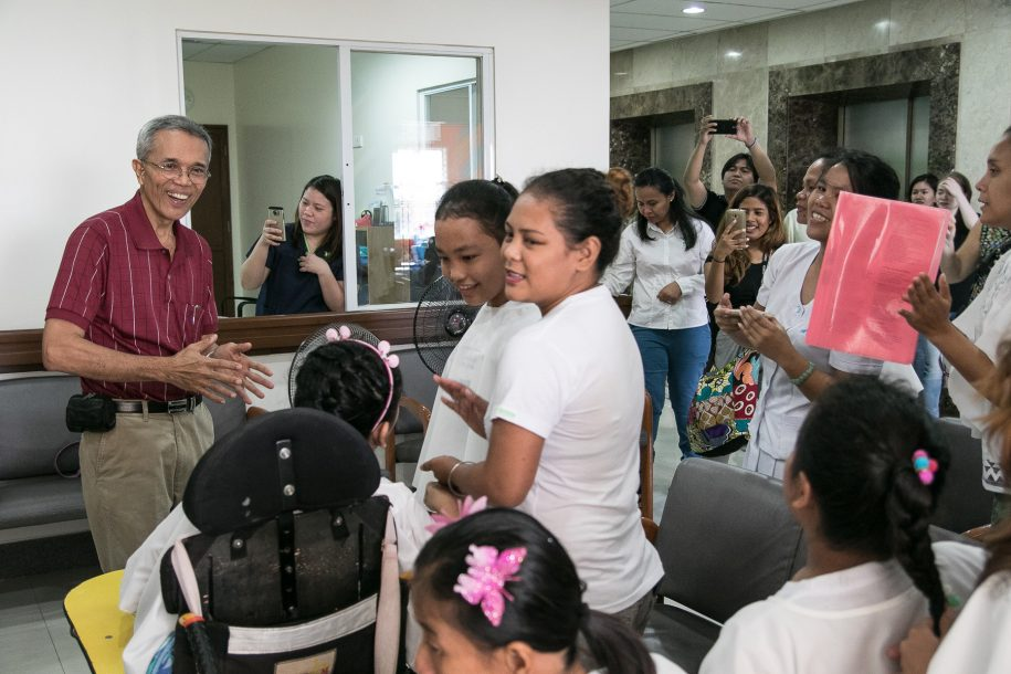Dr. Reyes turned 18 (again!) this week, so the residents from Our Lady of Victory surprised him with a chorus of Christmas and Birthday songs to thank him for his years of service.