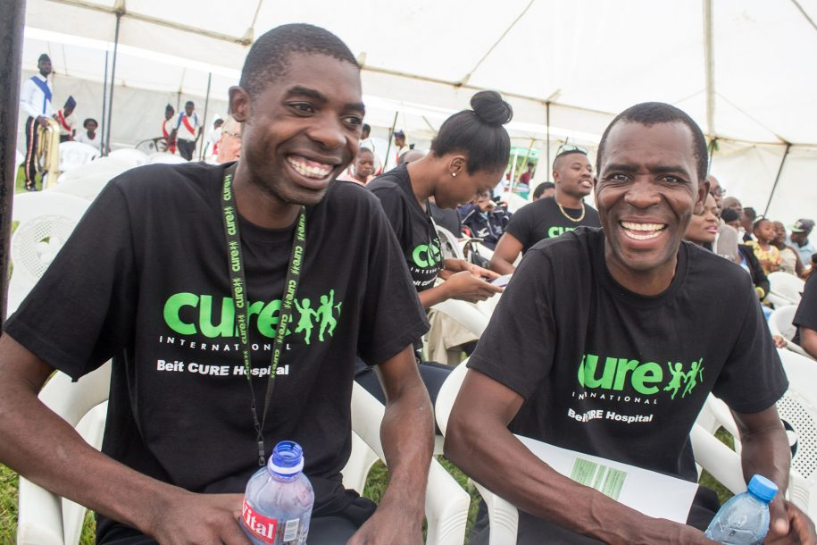 CURE drivers share a light moment during the 10 year Anniversary celebrations.