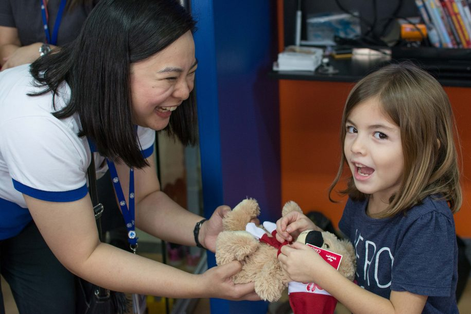 Hannah couldn't believe that instead of going to SM, a local shopping mall, to get a stuffed bear, SM came to us and gave her one for free!