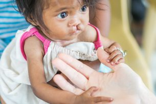 Five-month-old Maribel made a new friend at our mobile clinic!