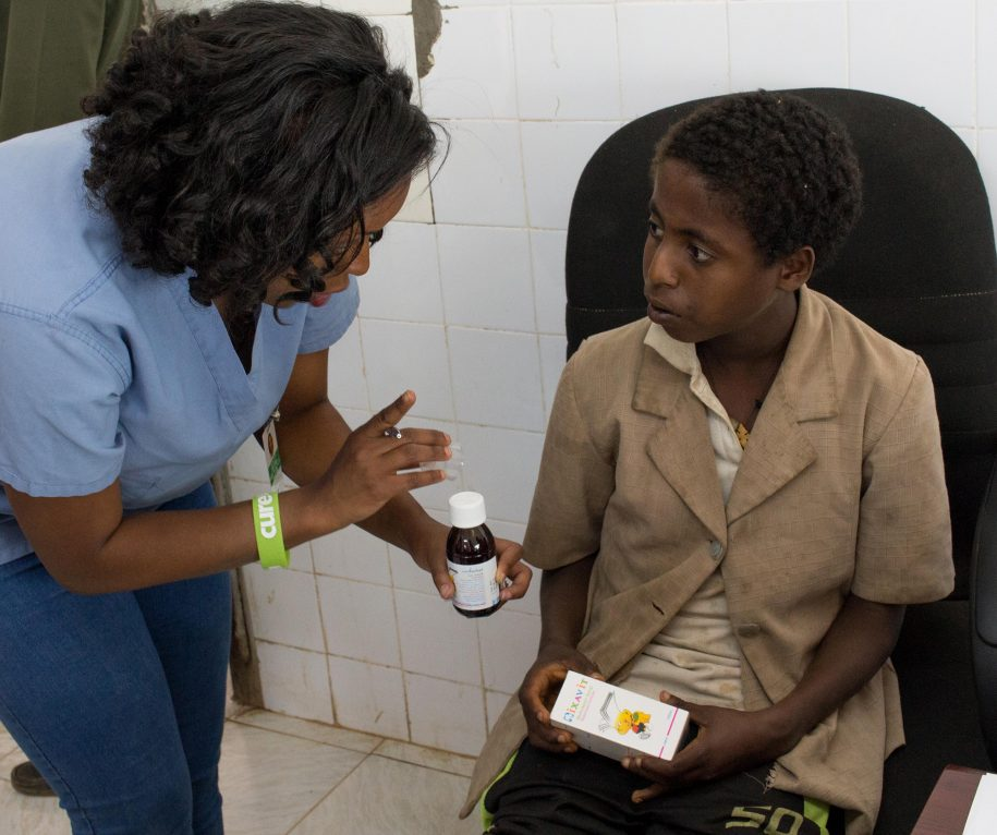 Our Head OP Nurse was instructing Getahun on how to take his multivitamins, so he may be better prepared for surgery.