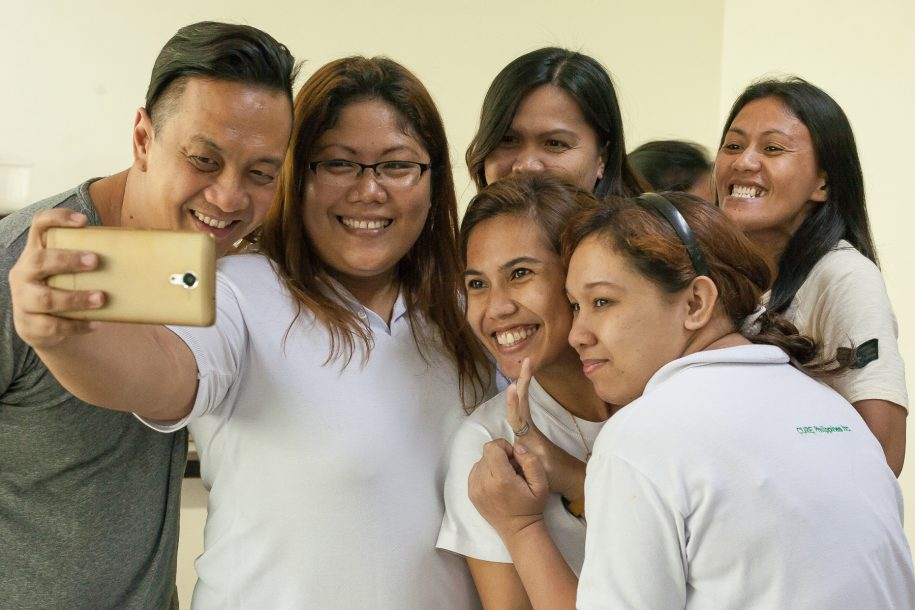 The ladies of our housekeeping staff introduce Switchfoot's Jerome Fontamillas to an important tradition: taking selfies!
