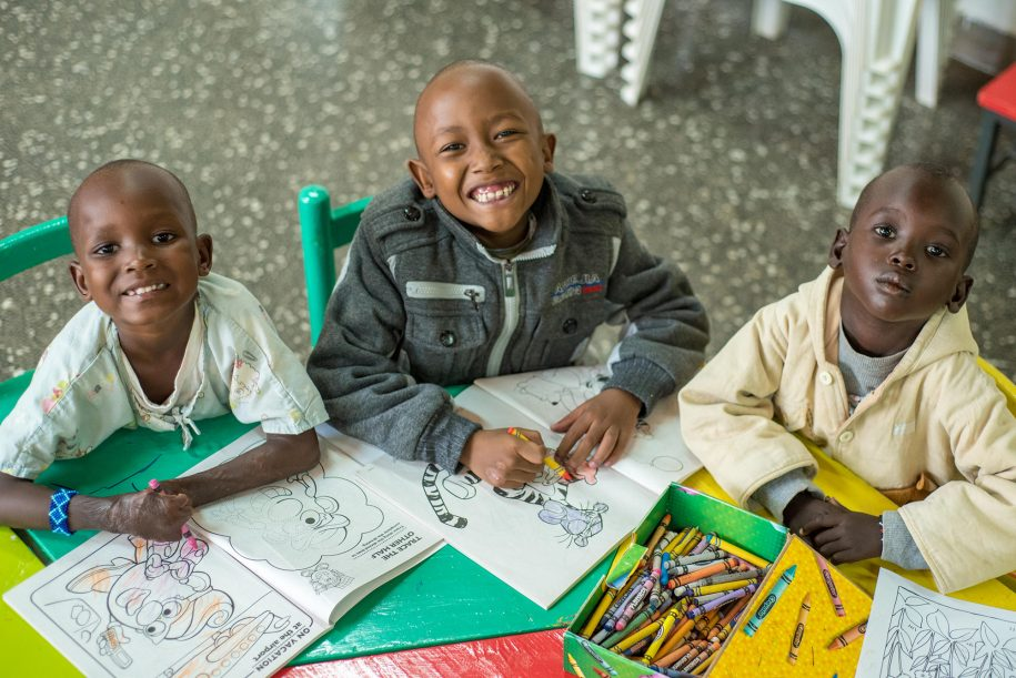 Vivian, Wayne, and Vitalis take a second from their busy coloring schedule to pause for a photo.