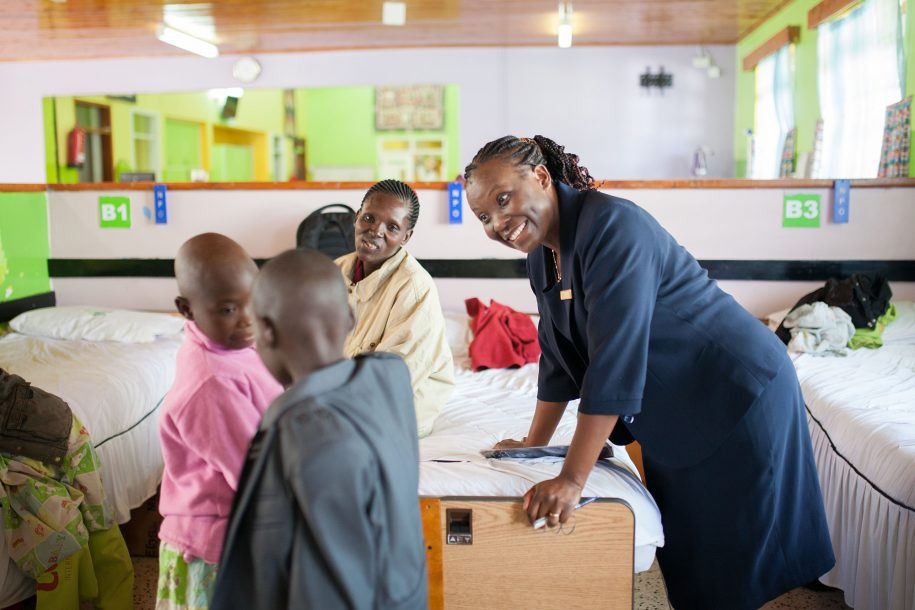Anne is our nurse matron. Here she's enjoying a moment with some of our kiddos.