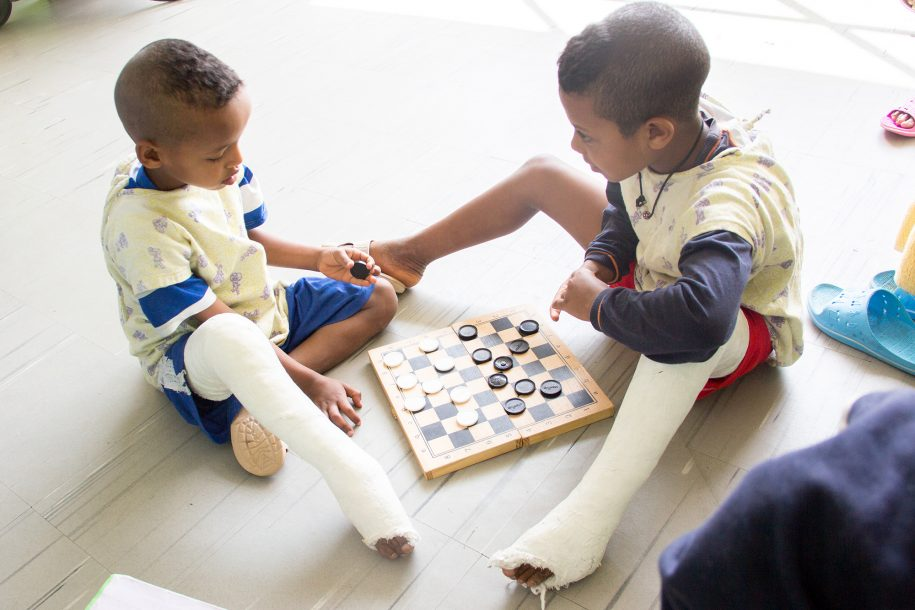 Abdu and Tadesse are getting very good at checkers!