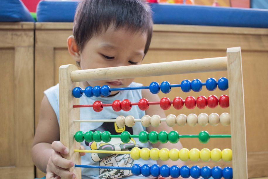 "Gerald continues to build his mathematical knowledge in the playroom as he counts, ""One, two, three, four, five, six, ten!"""