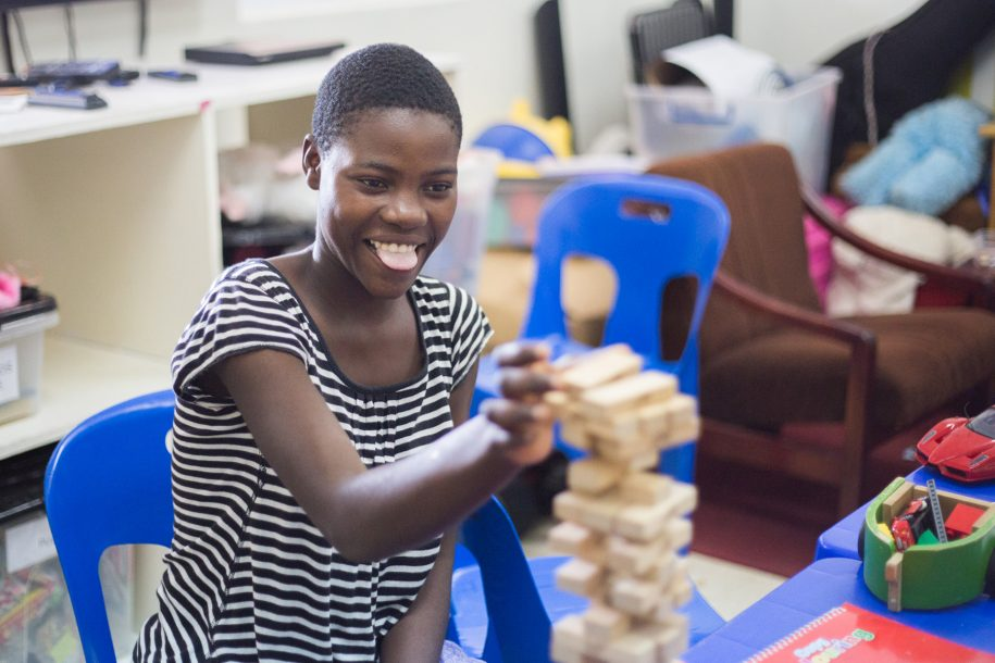 Malita was having a lot of fun playing Jenga with volunteer playroom assistant Cathy!