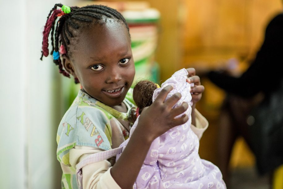 Pauline has her doll close to her, and she taking very good care of it. (Nelson Muoki)