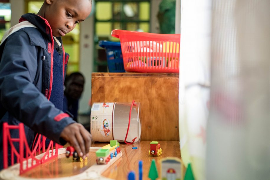 Tevin, one of our patients, in the playroom was giving some serious attention to his toys. (Nelson Muoki).