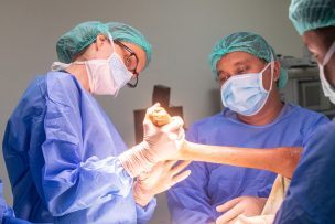 Dr. Shelley Oliver reviews a patient's leg in the operating room