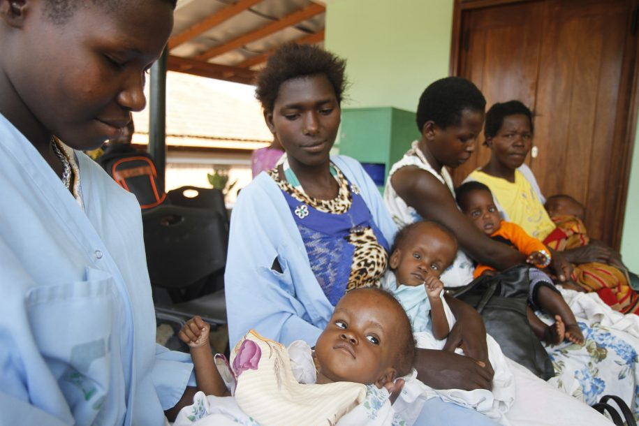 moms and babies in CURE Uganda waiting area